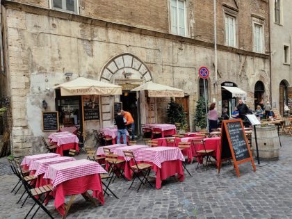 Restaurant at the very lively street in the Jewish ghetto of Rome
