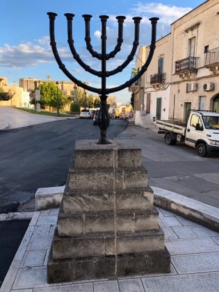 Menorah standing in a street of Puglia