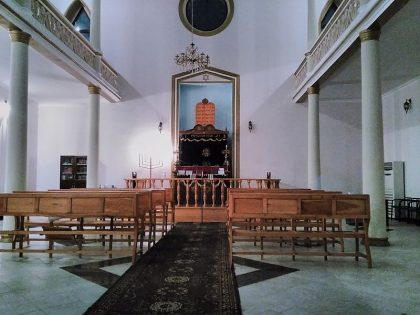 Inside the Batumi synagogue with great white walls